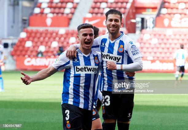 Adrian Embarba of RCD Espanyol celebrates with his teammate Adria Pedrosa of Espanyol after scoring the opening goal during the Liga Smartbank match...