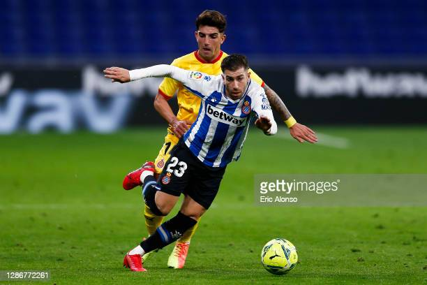 Adrian Embarba of RCD Espanyol competes for the ball with Monchu of Girona during the La Liga Smartbank match between RCD Espanyol and Girona at RCDE...