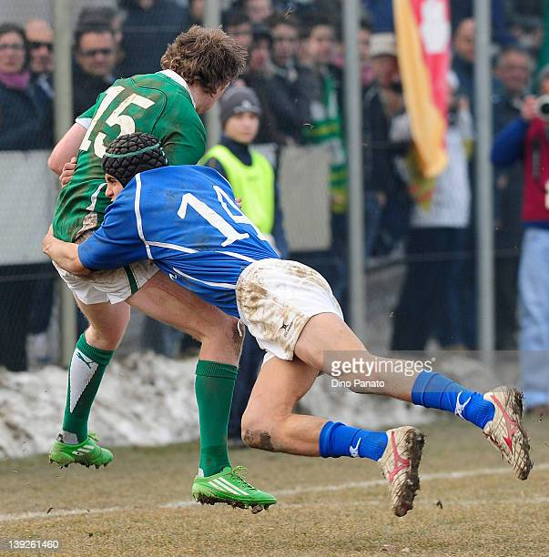 Adrian Enright of Ireland U18 is takled by Gabriele Di Giulio of Italy U18 during the U18 rugby test match between Italy U18 and Ireland U18 on...