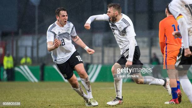Adrian Fein and scorer Manuel Wintzheimer celebrate their teams second goal during the Under 19 Euro Qualifier between Germany and Netherlands on...