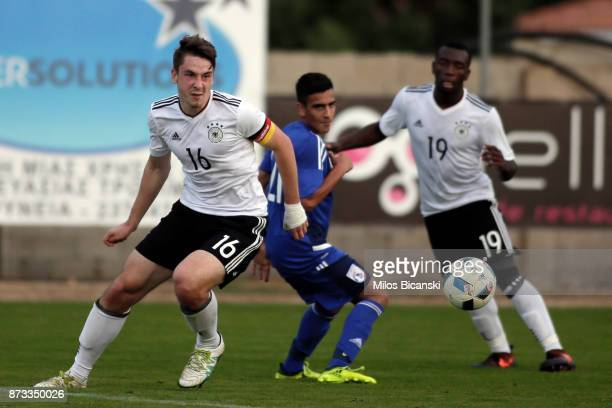 Adrian Fein and Uli Bapoh of Germany in action against Constantinos Elia of Cyprus during the U19 International Friendly between U19 Cyprus and U19...