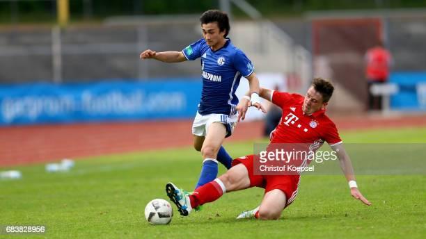Adrian Fein of Bayern challenges Nicholas Taitague of Schalke during the U19 German Championship Semi Final second leg match between FC Schalke and...