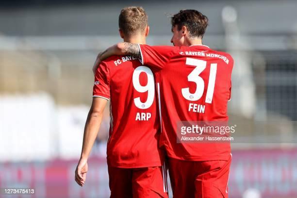 Adrian Fein of Bayern II celebrates scoring the first team goal with his team mate Jann-Fiete Arp during the 3. Liga match between Bayern Muenchen II...
