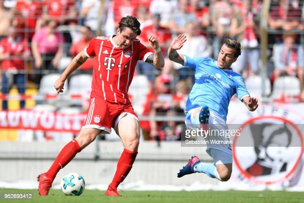 Adrian Fein of Bayern Meunchen and Nico Karger of 1860 Muenchen compete for the ball during the Regionalliga Bayern match between FC Bayern Muenchen...