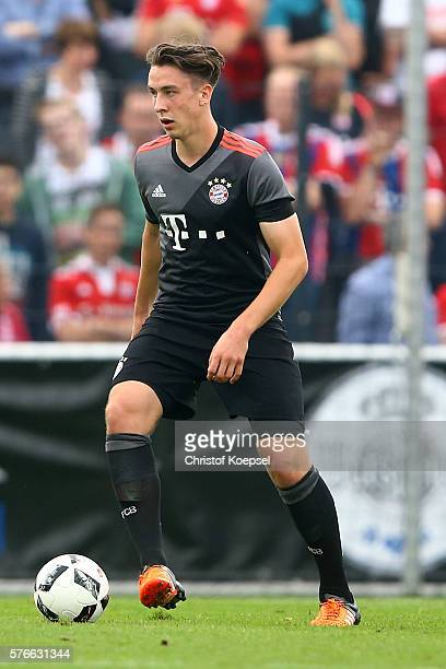 Adrian Fein of Bayern Muenchen runs with the ball during the friendly match between SV Lippstadt and FC Bayern at Stadion am Bruchbaum on July 16...