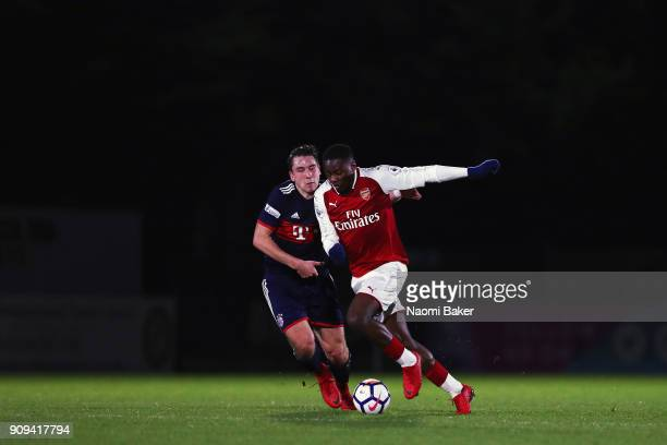 Adrian Fein of Bayern Munich battles for posession with Josh Da Silva of Arsenal during the Premier League International Cup match between Arsenal...