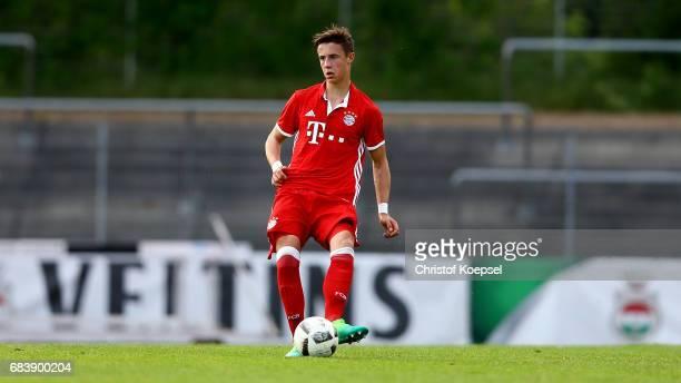 Adrian Fein of Bayern runs with the ball during the U19 German Championship Semi Final second leg match between FC Schalke and FC Bayern at Lohrheide...