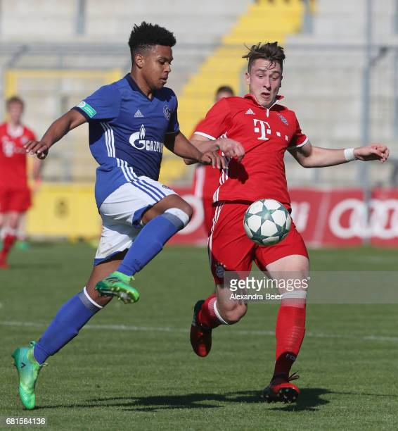 Adrian Fein of FC Bayern Muenchen fights for the ball with Weston Mc Kennie of FC Schalke 04 during the AJuniors semi final first leg German...
