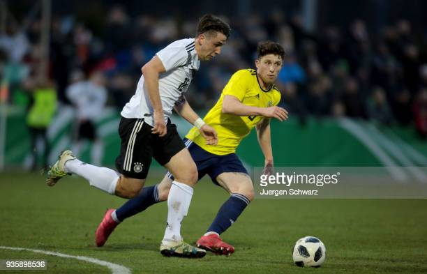 Adrian Fein of Germany and Jamie Barjonas of Scotland fight for the ball during the Under 19 Euro Qualifier between Germany and Scotland on March 21...