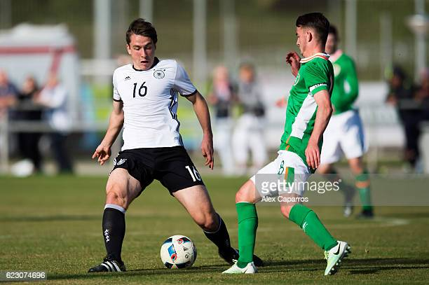 Adrian Fein of Germany competes for the ball with Daniel McKenna of Ireland during the U18 international friendly match between Ireland and Germany...