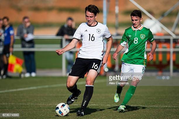 Adrian Fein of Germany conducts the ball next to Daniel McKenna of Ireland during the U18 international friendly match between Ireland and Germany on...
