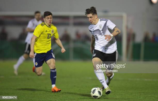 Adrian Fein of Germany controls the ball near Jack Aitchison of Scotland during the Under 19 Euro Qualifier between Germany and Scotland on March 21...