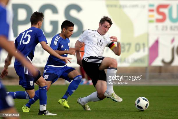 Adrian Fein of Germany in action against Constantinois Elia of Cyprus during the U19 International Friendly between U19 Cyprus and U19 Germany at...