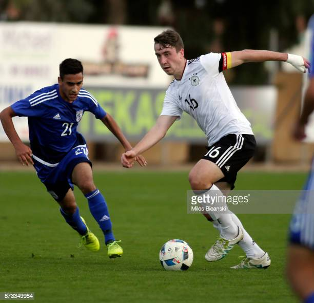 Adrian Fein of Germany in action against Constantinos Elia of Cyprus during the U19 International Friendly between U19 Cyprus and U19 Germany at...