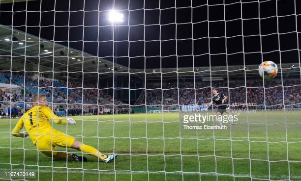 Adrian Fein of Hamburg scored the winning penalty in the shootout after extra time past goalkeeper Jakub Jakubov of Chemnitz during the DFB Cup first...
