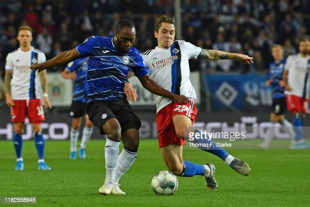 Adrian Fein of Hamburg tackles Reinhold Yabo of Bielefeld during the Second Bundesliga match between DSC Arminia Bielefeld and Hamburger SV at...