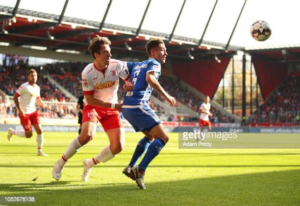 Adrian Fein of Jahn Regensburg challenges Marvin Mehlem of SV Darmstadt 98 during the Second Bundesliga match between SSV Jahn Regensburg and SV...