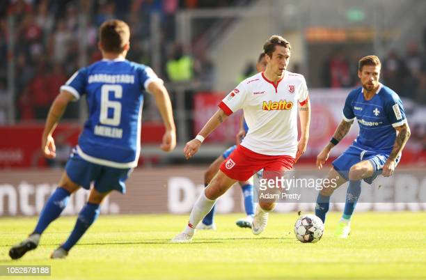 Adrian Fein of Jahn Regensburg controls the ball during the Second Bundesliga match between SSV Jahn Regensburg and SV Darmstadt 98 at Continental...