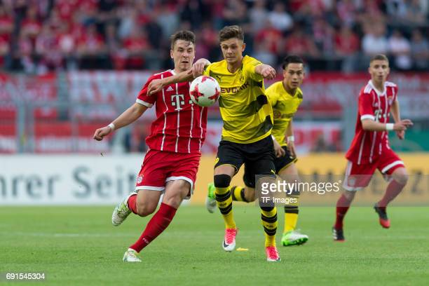 Adrian Fein of Munich and Alexander Laukart of Dortmund battle for the ball during the U19 German Championship Final match between U19 Borussia...