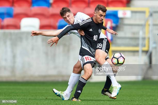 Adrian Fein of U19 Germany fights for the ball with Miroslav Khlebosolov of U19 Belarus during the UEFA Under19 Euro Qualifier between U19 Germany...