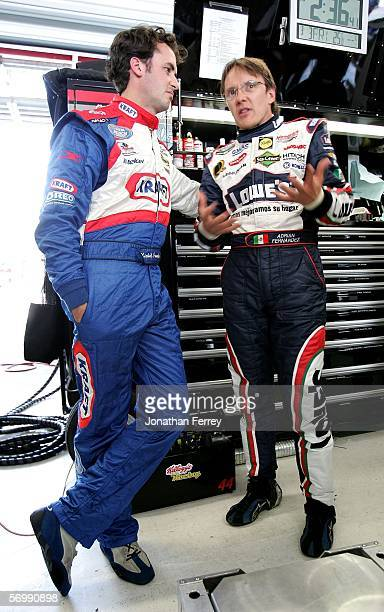 Adrian Fernandez driver of the Lowe's Chevrolet chats with Michel Jourdain Jr. Driver of the Roshfrans Ford during practice for the NASCAR Busch...