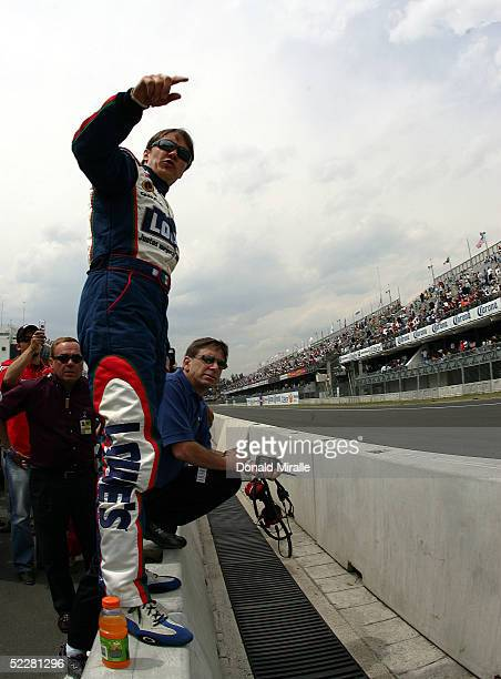 Adrian Fernandez of Mexico, driver of the Lowe's Chevrolet Monte Carlo, and Crew Chief Jim Long watch track conditions during qualifying for the...