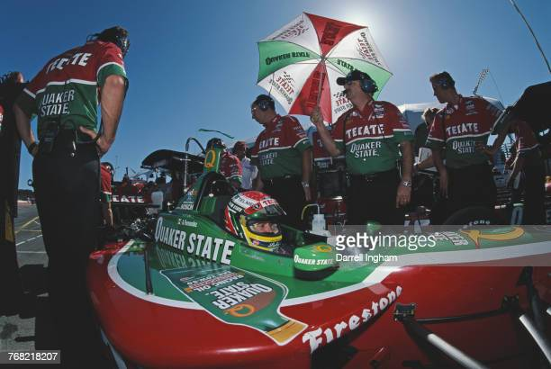 Adrian Fernandez of Mexico sits aboard the Tecate Quaker State Patrick Racing Reynard 2KI FordCosworth XF in the pits during practice for the...