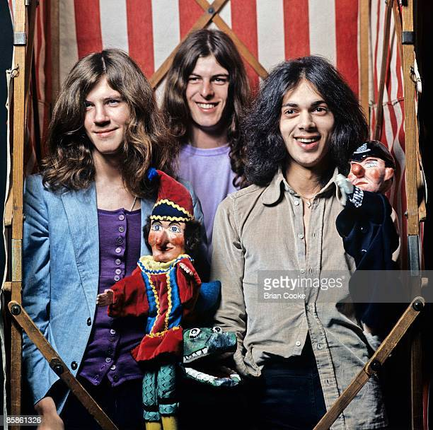 Adrian Fisher Stan Speake Andy Fraser Toby posed studio group shot holding Punch Judy dolls in London in November 1971