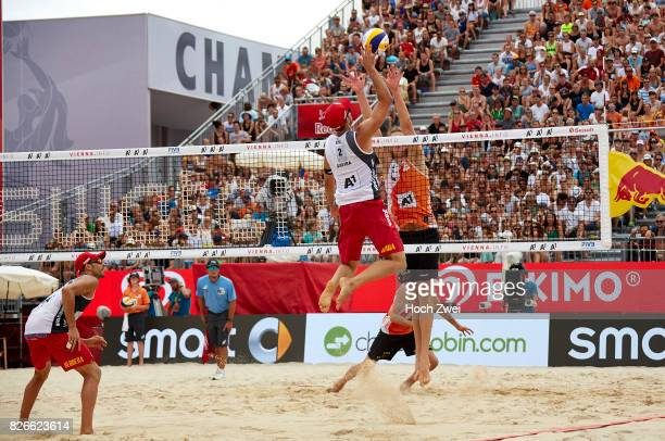 Adrian Gavira Collado of Spain competes against Christiaan Varenhorst of Netherlands during Day 9 of the FIVB Beach Volleyball World Championships...