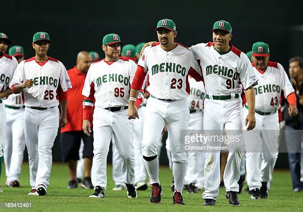 Adrian Gonzalez and Alfredo Aceves of Mexico walk off the field with teammates before the World Baseball Classic First Round Group D game against...