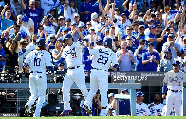 Adrian Gonzalez celebrates his tworun homerun with Joc Pederson and Justin Turner of the Los Angeles Dodgers in the first inning against the...