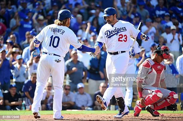 Adrian Gonzalez celebrates his tworun homerun with Justin Turner of the Los Angeles Dodgers in the first inning against the Washington Nationals...