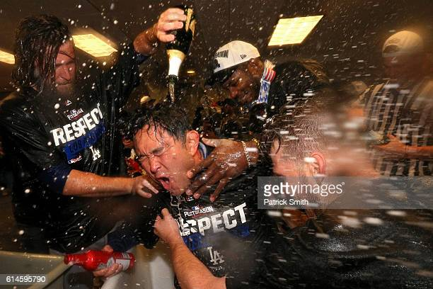 Adrian Gonzalez Josh Reddick and Justin Turner of the Los Angeles Dodgers celebrate in the clubhouse after winning game five of the National League...