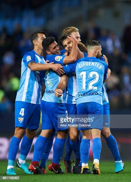 Adrian Gonzalez of Malaga CF celebrates after scoring goal during the Copa match between Malaga CF and Numancia at La Rosaleda Stadium on November 28...
