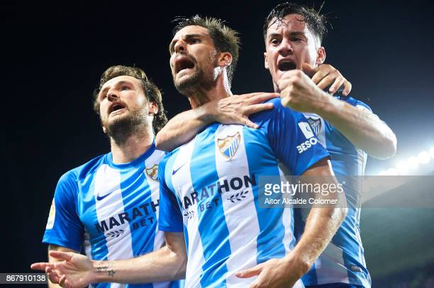 Adrian Gonzalez of Malaga CF celebrates after scoring the first goal for Malaga of CF with his team mate Juan Pablo Anor 'Juanpi' of Malaga CF during...