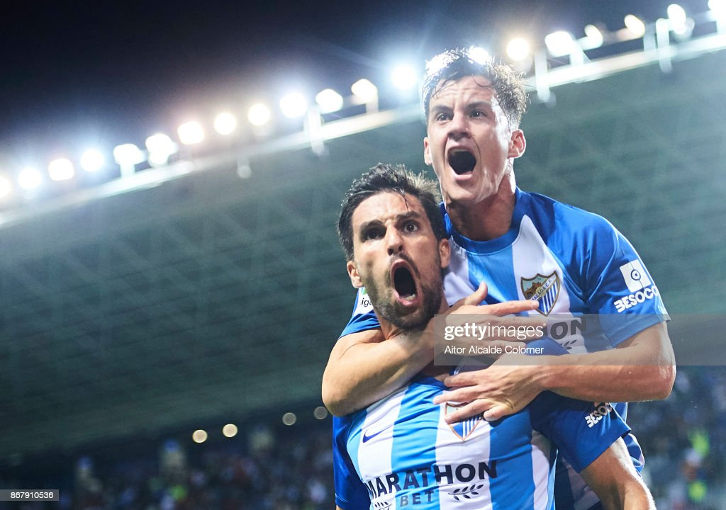 Adrian Gonzalez of Malaga CF celebrates after scoring the first goal for Malaga of CF with his team mate Juan Pablo Anor 'Juanpi' of Malaga CF during the La Liga match between Malaga and Celta de Vigo at Estadio La Rosaleda on October 29, 2017 in Malaga, Spain.