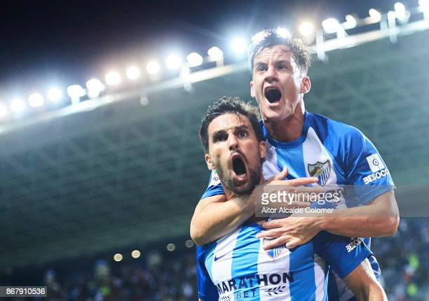 Adrian Gonzalez of Malaga CF celebrates after scoring the first goal for Malaga of CF with his team mate Juan Pablo Anor Juanpi of Malaga CF during...