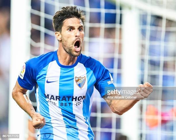 Adrian Gonzalez of Malaga CF celebrates after scoring the first goal for Malaga of CF during the La Liga match between Malaga and Celta de Vigo at...