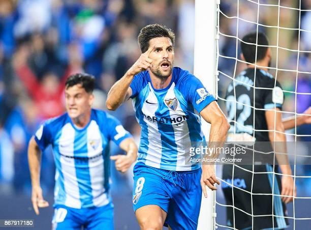 Adrian Gonzalez of Malaga CF celebrates after scoring the first goal for Malaga of CF during the La Liga match between Malaga and Celta de Vigo at...