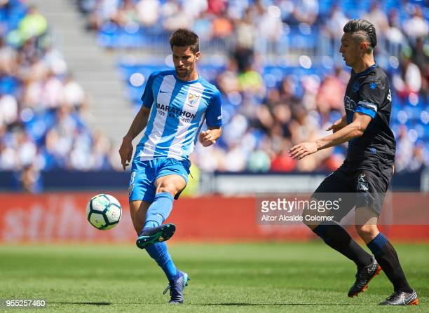 Adrian Gonzalez of Malaga competes for the ball with Daniel Torres of Deportivo Alaves during the La Liga match between Malaga and Deportivo Alaves...