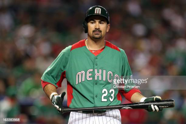 Adrian Gonzalez of Mexico reacts after he walked against the United States during the World Baseball Classic First Round Group D game at Chase Field...