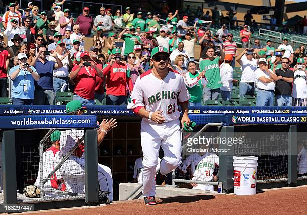 Adrian Gonzalez of Mexico runs out onto the field during introductions to the World Baseball Classic First Round Group D game against Itlay at Salt...