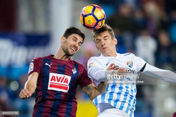 Adrian Gonzalez of SD Eibar duels for the ball with Diego Javier Llorente of Malaga CF during the La Liga match between SD Eibar and Malaga CF at...