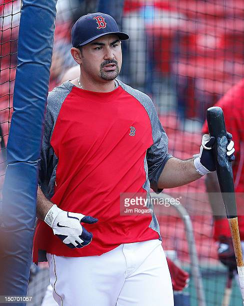 Adrian Gonzalez of the Boston Red Sox leaves the batting cage before a game with the Kansas City Royals at Fenway Park on August 24 2012 in Boston...