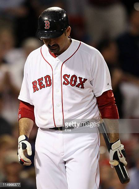Adrian Gonzalez of the Boston Red Sox walks back to the dugout after striking out to end the game on May 31, 2011 at Fenway Park in Boston,...