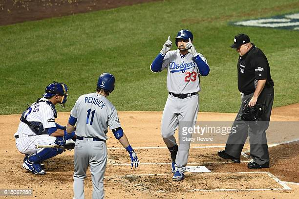 Adrian Gonzalez of the Los Angeles Dodgers celebrates after hitting a solo home run in the second inning against the Chicago Cubs during game two of...