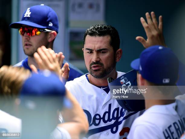 Adrian Gonzalez of the Los Angeles Dodgers celebrates his run in the dugout to take a 21 lead over the Washington Nationals during the sixth inning...