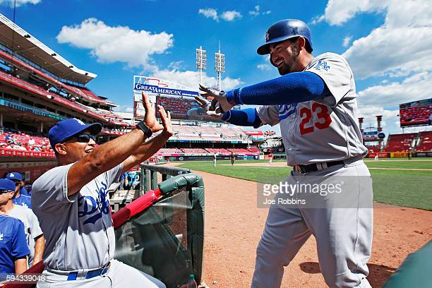 Adrian Gonzalez of the Los Angeles Dodgers celebrates with manager Dave Roberts after hitting a threerun home run in the seventh inning for his third...