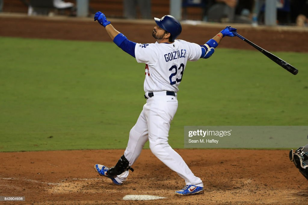 Adrian Gonzalez #23 of the Los Angeles Dodgers follows through on a swing during a game against the Arizona Diamondbacks at Dodger Stadium on September 5, 2017 in Los Angeles, California.