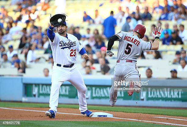 Adrian Gonzalez of the Los Angeles Dodgers gets the force out at first base on Ender Inciarte of the Arizona Diamondbacks in the first inning during...
